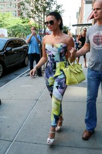 The gorgeous Demi Lovato looking incredible in the Bardot 'Acid Floral Jumpsuit' - cred: Fashion Trend Seeker